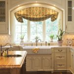 garden windows for kitchen farmhouse sink wood countertops recessed panel cabinets hardwood floors ceiling lights island decorative plants traditional design