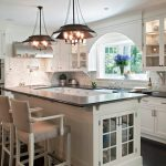 garden windows for kitchen solid surface countertops shaker cabinets undermount sink stone tile backsplash low back chairs stainless steel appliances chandeliers dark hardwood floors farmhouse style