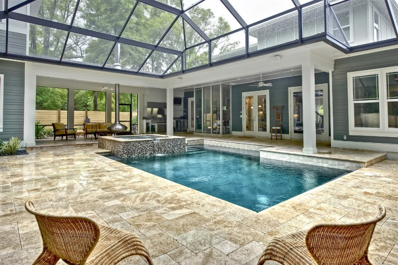 glass screened interior pool design pavers flooring idea square shaped interior pool two rattan chairs smaller hot tub