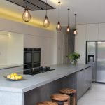 glass stove on grey concrete top kitchen island