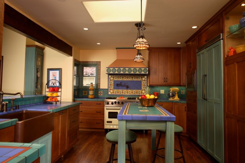 good colors for kitchens recessed panel cabinets tile countertops multicolored backsplash paneled appliances farmhouse sink table stools pendants ceiling lights hardwood floors mediterranean design