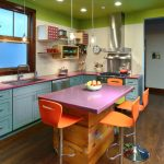 good colors for kitchens shaker cabinets undermount sink white backsplash island stools hardwood floors stainless steel appliances glass pendants ceiling lights hanging shelves eclectic design