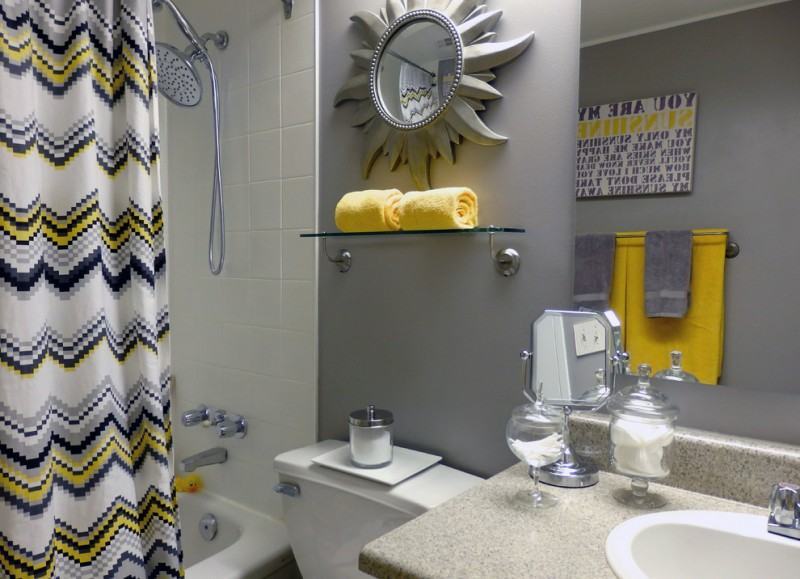 grey wall bathroom design yellow towels white shower curtain with black & yellow accent grey marble top bathroom vanity
