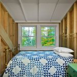 Guest Bed For Small Space Wooden Walls Windows Pillows Small Green Table Lamp Farmhouse Bedroom