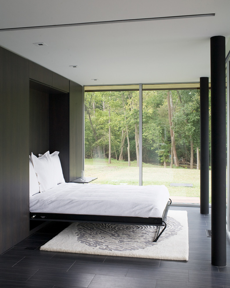 guest bed for small spaces dark floor carpet pillows glass pillars contemporary style bedroom