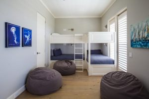 guest beds for small spaces painting ladder pillows wood floor beach style bedroom