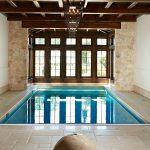 Interior Pool With Dark Hardwood Enclosure Light Beige Stones Walls White Walls Pale Toned Limestone Floors