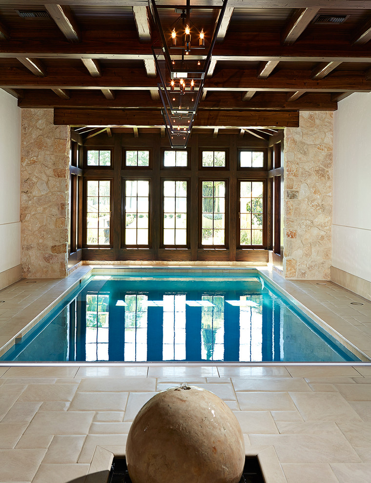 interior pool with dark hardwood enclosure light beige stones walls white walls pale toned limestone floors