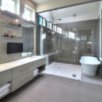 jacuzzi tub shower combo big floor tiles wall tv glass shelves windows towels faucet sink contemporary bathroom