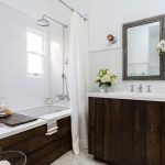 Jacuzzi Tub Shower Combo Flowers White And Wood Small Window Curtains Cool Lamps Faucets Farmhouse Bathroom