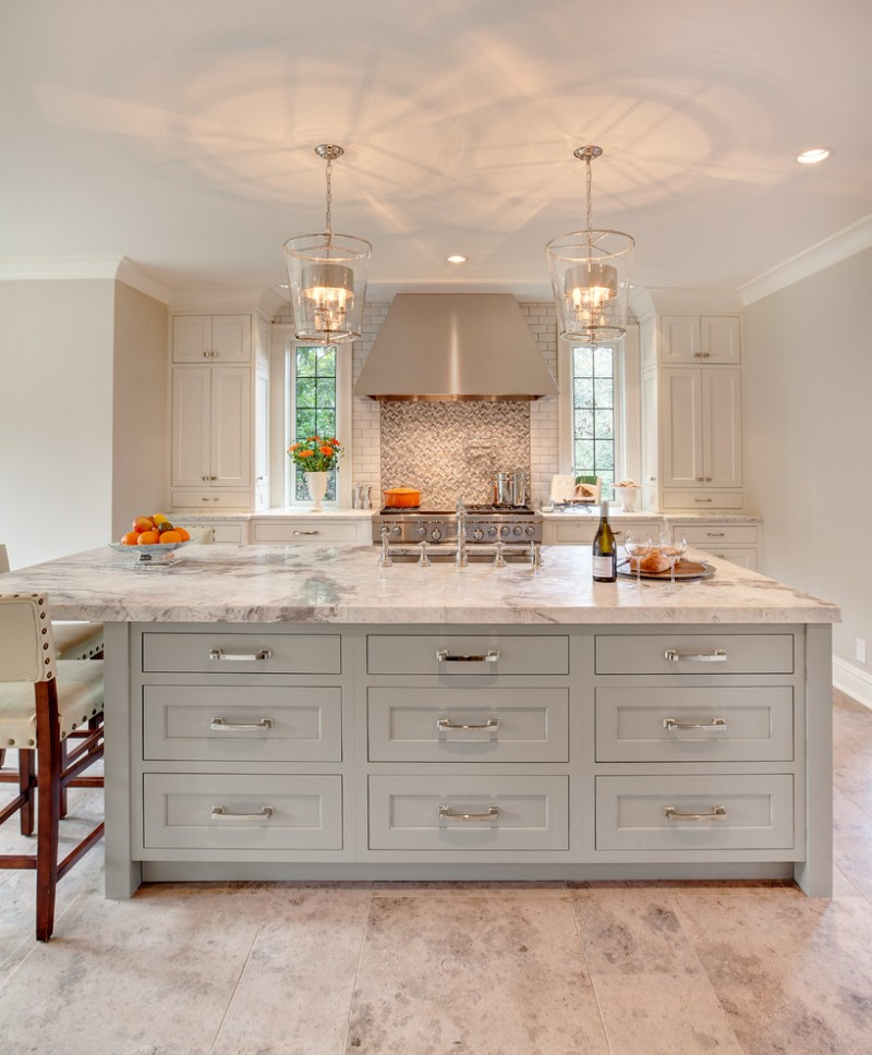 kitchen island with white marble top chrome handled drawer system and modern bar chair in white