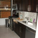 kitchen remodeling nyc floor tiles wall cabinet window stove trash bin countertop sink faucet contemporary kitchen