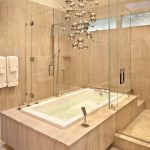 light over tub possini lighting deck mount faucet chandeliers in bathrooms glass bathtub cascade white