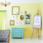 Light Yellow Painted Wall Idea Blue Console Table Decorative Picture Frames Bright Yellow Chair Linen Room Divider With Colorful Flower Motifs White Floorboards Wood Painting Property