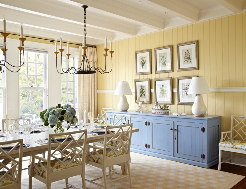 light yellow siding walls blue accent storage pale toned wood chairs with flower patterned seaters light orange area rug with white accent motifs