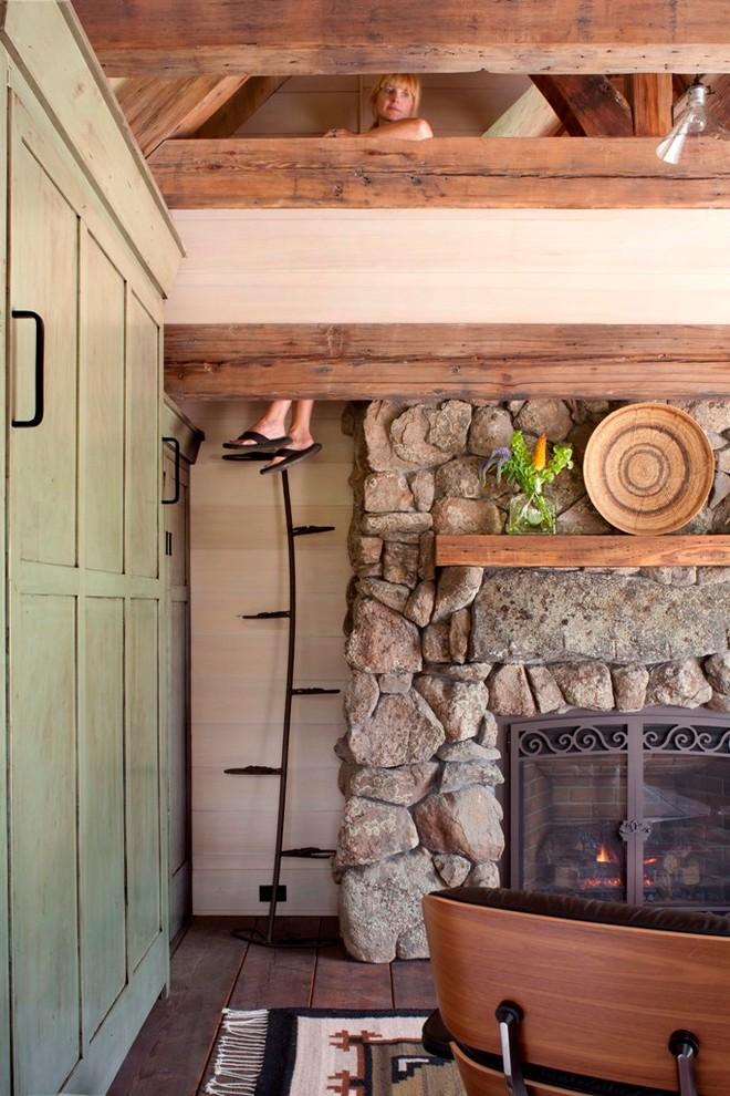loft ladder ideas green doors hardwood floors ornate glass door fireplace hanging shelf decorations stone walls rustic style