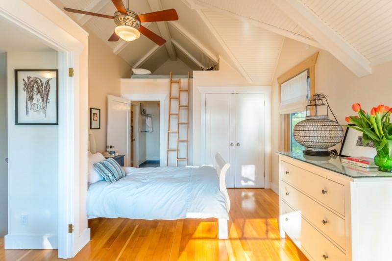 loft ladder ideas lofted nook glass top cabinet ceiling fan beige walls hardwood floors bed blue sheets pillows closet traditional design