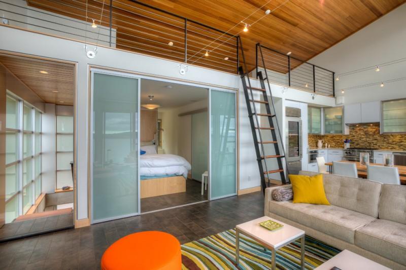loft ladder ideas sofa ottoman carpet dining table chairs backsplash kitchenette cabinets ceiling lights hardwood floors double glass doors beach style