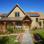 luxury ranch house plans beige walls stone pavers wood doors white frame windows pool garden rustic design