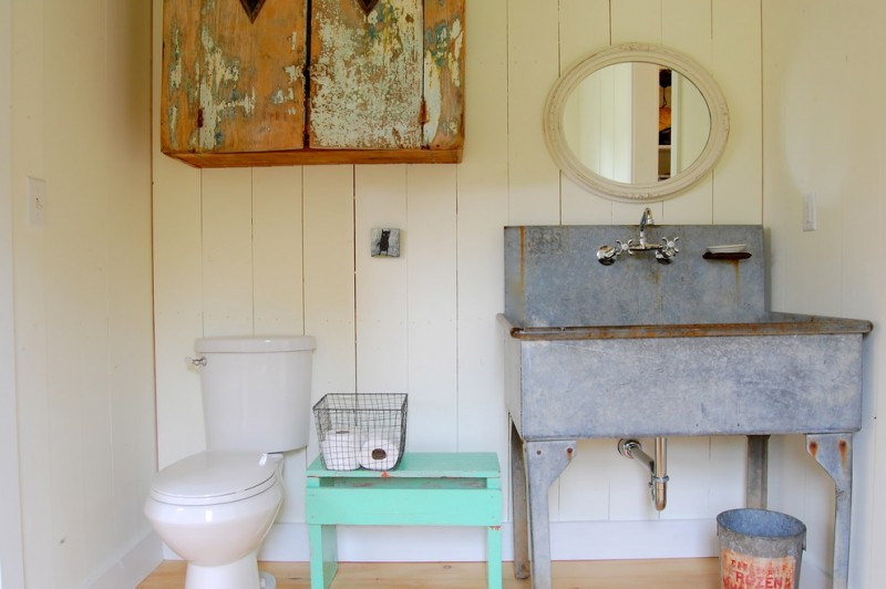modern farmhouse bathroom with colorful vintage furniture and bathroom fixtures
