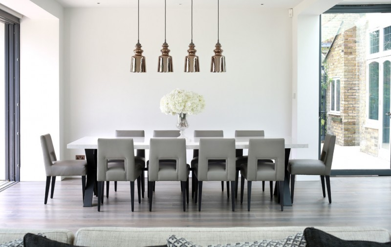 modern pendants low back chairs hardwood floors oversized windows floral centerpiece contemporary design