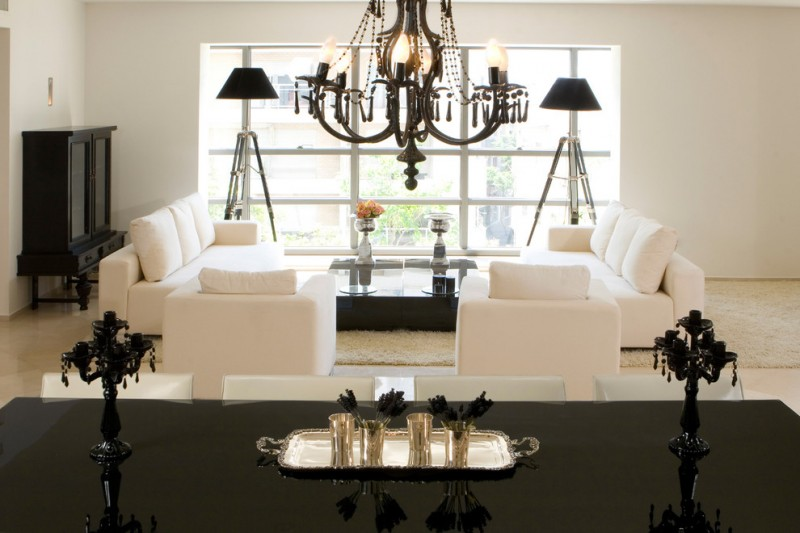 morning room furniture white sofa black ottoman chandelier long table standing lamps wooden shelves beige walls contemporary design