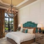 Ornate Bedroom Furniture Bed Pillows Tables Lamps Window Curtains Chandelier Traditional Style Room