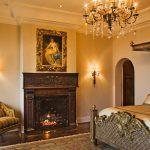Ornate Bedroom Furniture Chandelier Bed Chair Wall Lamp Carpet Fireplace Hardwood Floor Mediterranean Style