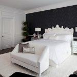 Ornate Bedroom Furniture Chandelier Carpet Hardwood Floor Flowers Lamps Table Transitional Style Room Pillows Mirror