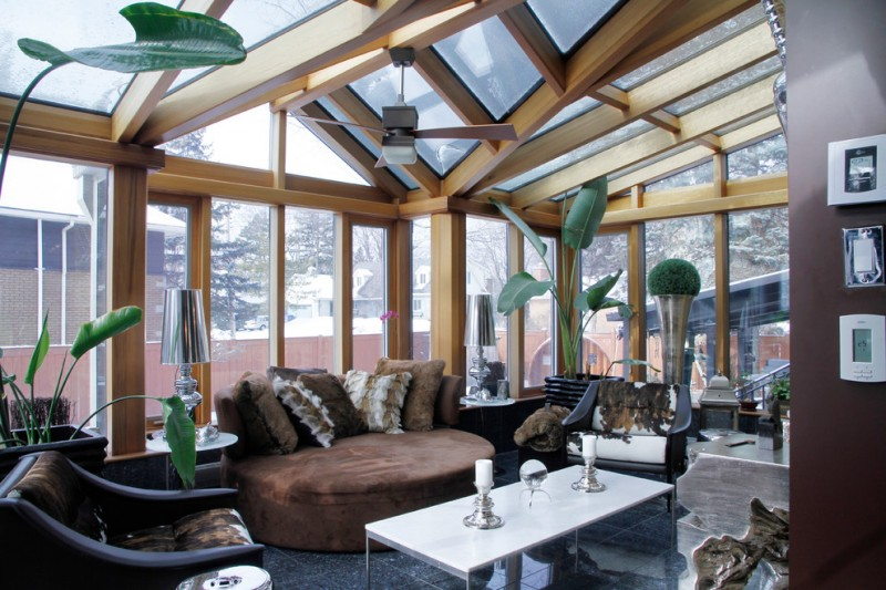 oversized couches living room ceiling fan screen panels marble floors tables decorations tropical indoor plants throw pillows transitional design