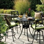 patio furniture seattle hedges outdoor pub table metal pub chairs green cushion cream patterned pillow