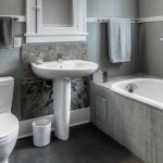 pedestal sink with backsplash bathtub toilet faucet towel racks lamp contemporary bathroom