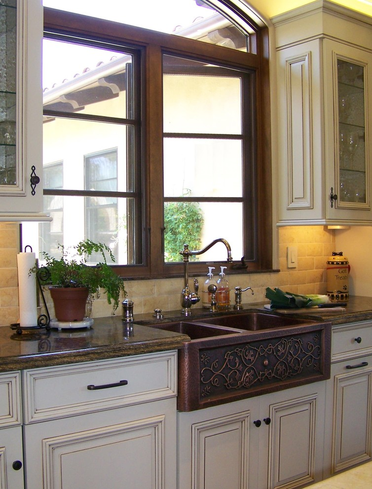 pedestal sink with backsplash cabinets window stone tiles traditional style decorative plant