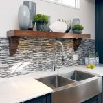 pedestal sink with backsplash drawers hanging shelf storage decorative plants vases bottles transitional design