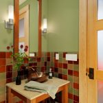 pedestal sink with backsplash table shelf vase hanging lamps checkered tiles door traditional design