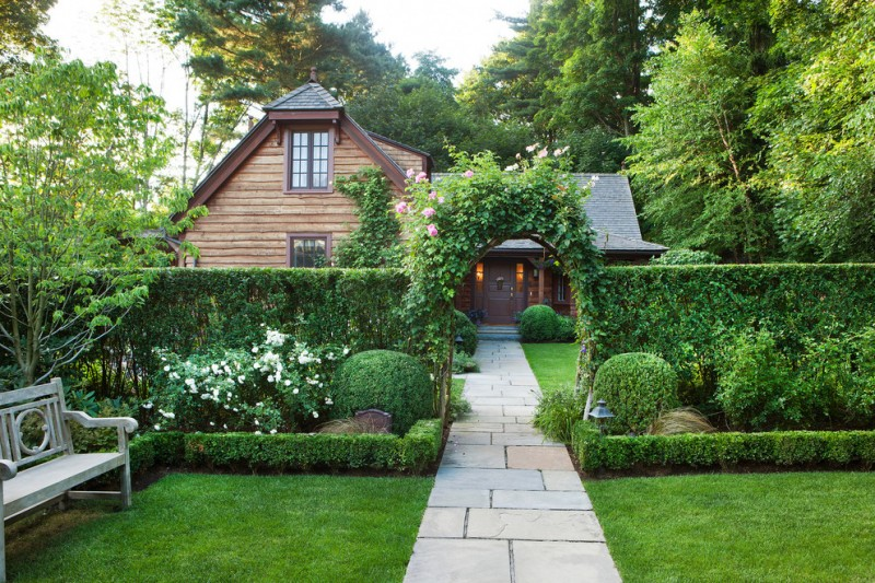 plants wall flower vines gateway bluestone pavers grass green bench chair wooden deck wall