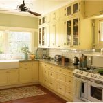 popular paint colors for kitchens dunn edwards bugetti yellow color patterned rug pull out kitchen cabinet large kitchen windows