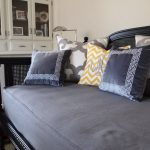 pottery barn daybed cover grey pillows lamp cabinet traditional style room