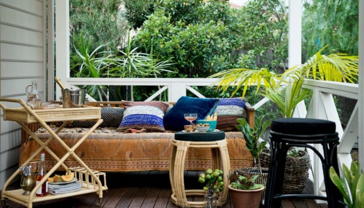 pottery barn daybed cover wood floor stool tables pillows decorative plants tropical porch