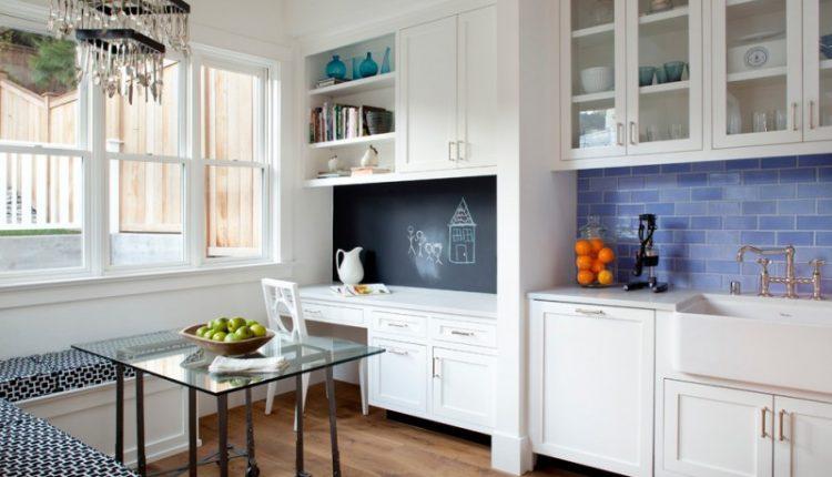 rectangular glass table board wall white cabinet white chair light toned wooden floors white wall ceiling pendant lamp blue backsplash