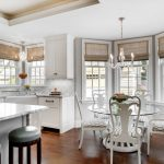 round table breakfast nooks white marble countertop kitchen cabinet chandelier lamp white cabinet raised cabinet ceiling medium toned floor