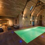 Rustic Interior Pool With Wood Slabs Enclosure Natural Stones Walls Wood Slabs Floorings Glass Sliding Door