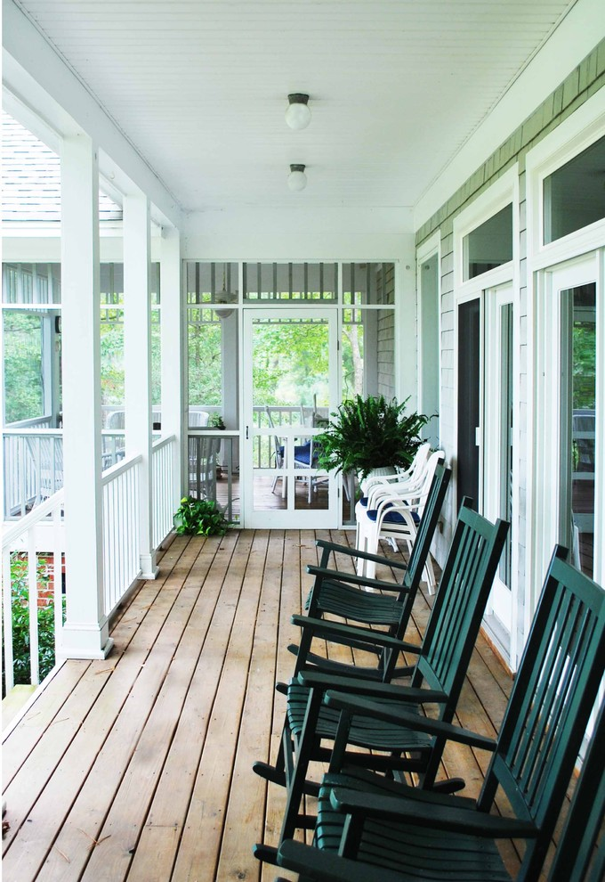 screen porch designs decking tall back rocking chairs armchairs ceiling lamps white railing glass door flower urn traditional design