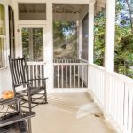 Screen Porch Designs Tall Back Rocking Chairs Small Table White Railing Concrete Floors Glass Door Long Windows Patio Farmhouse Design