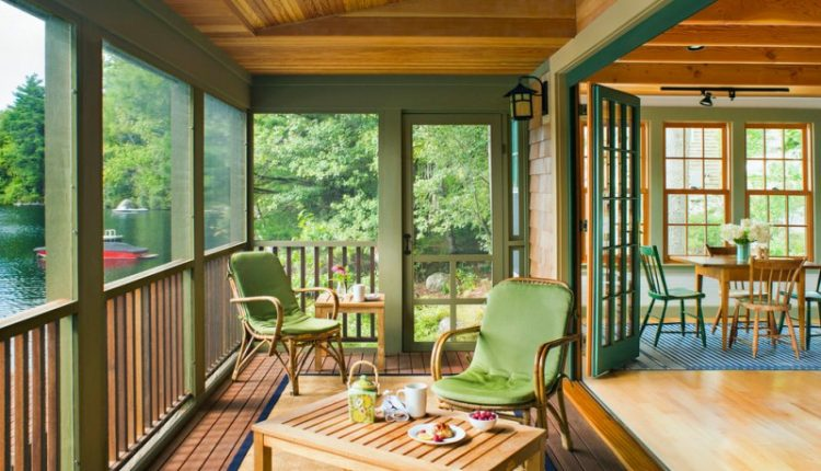 screen porch designs wood column ceiling roof extension railing hardwood floors tall back chairs tables light fixtures decking rustic design