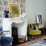 Shabby And Dirty Yellow Chair White Decorative Mantel Hand Painting With Dominant Yellow Dark Toned Hardwood Floors Glamour Wallpaper On Walls