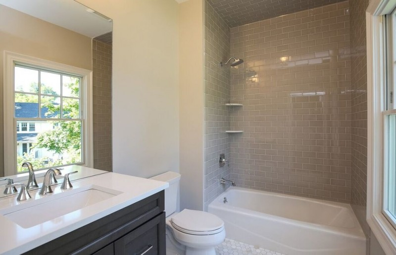 shaker cabinets walk in shower tub combo gray tile ceramic floors porcelain tile black cabinets two piece toilet