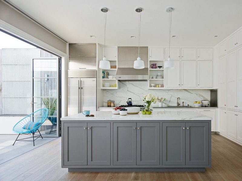 simple transitional kitchen idea with white marble top kitchen island completed with grey painted cabinets jflat panel & whie kitchen cabinets white marble backplash wood floors