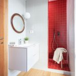 Small Bathroom With Red Tiles Shower Space Floating White Vanity Round Shaped Mirror With Wood Frame Wooden Floors White Ceramic Tiles Walls
