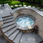 Stoney Round Hot Tub In The Bottom Of The Staircase With Limestone Walls And Silver Valley Landing